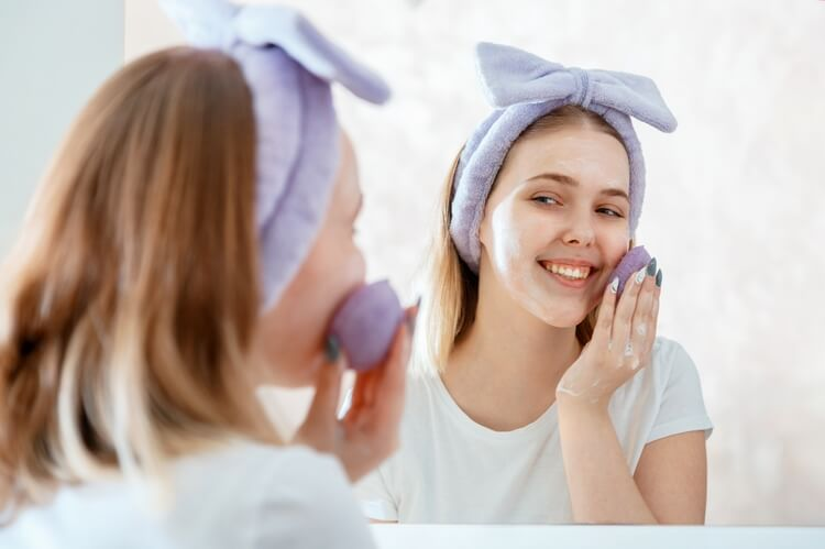 302woman-washes-her-face-with-natural-sponge-