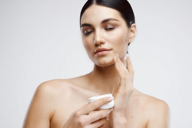 603brunette-bare-shoulders-cream-jar-dermatology