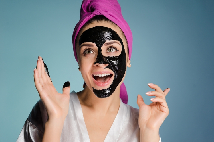 702happy-smiling-girl-with-pink-towel-n-agolovo-puts-black-mask-against-acne-face