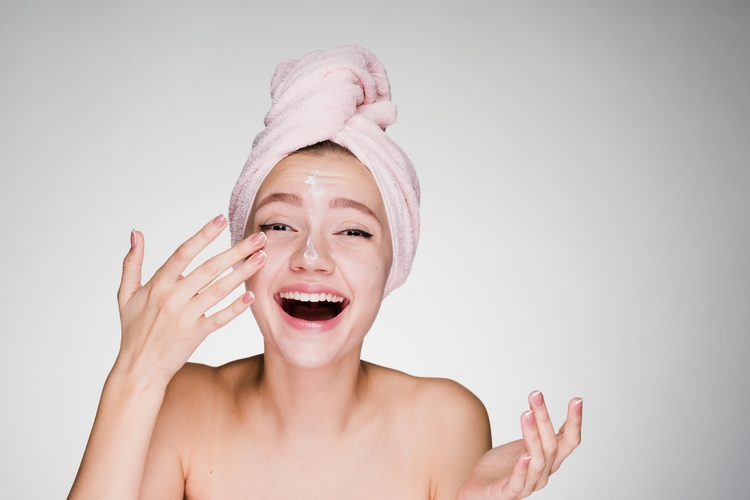 703happy-woman-with-towel-her-head-applied-cream-face